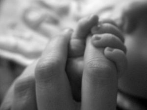 Mother and baby hands
